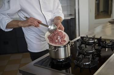 Fry the diced veal in the butter
