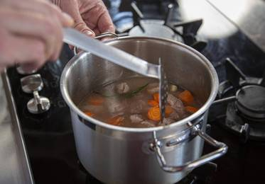 Add the vegetables and herbs and bring to the boil